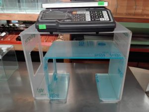 Plexiglas table under the scales
