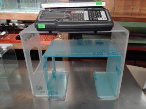 Plexiglas table under the scales